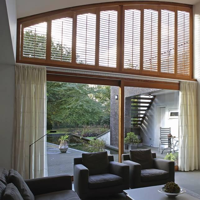 brown window shutter for upper window