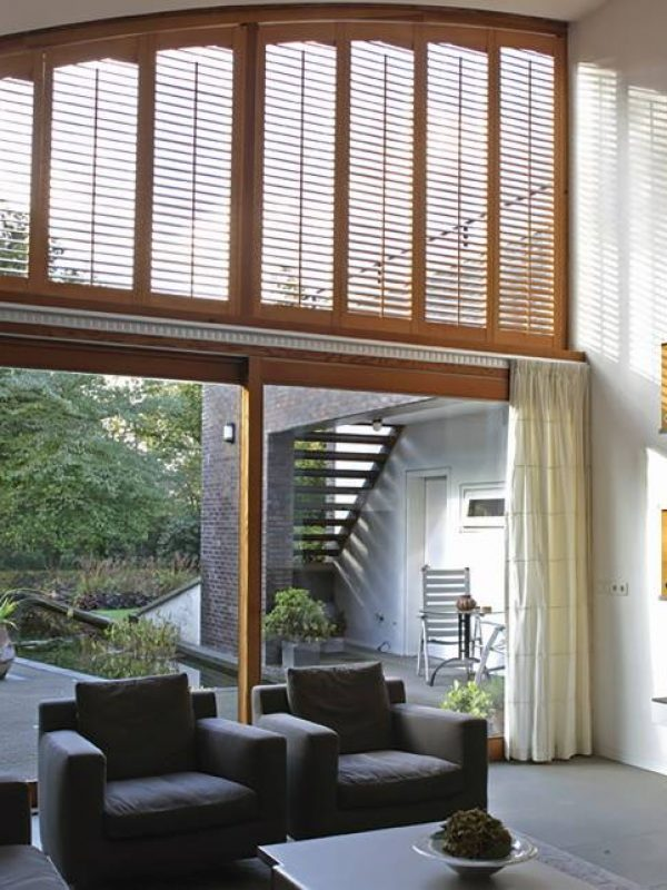 Brown shutter blind for large window the shutter company