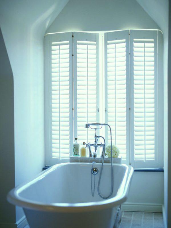 Italian style white window shutters in modern bathroom