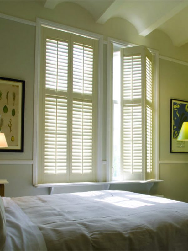 bedroom with café style French windows