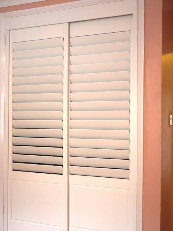 white door shutters inside house