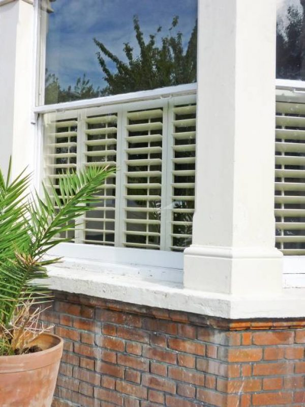 shutters for bay windows outside of building Fitted by the shutter company Newport
