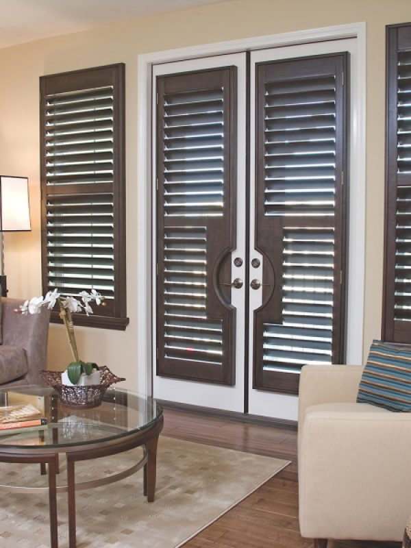 inside decorative brown shutters fitted by the shutter company