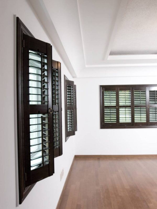 Brown full height shutters in a hallway