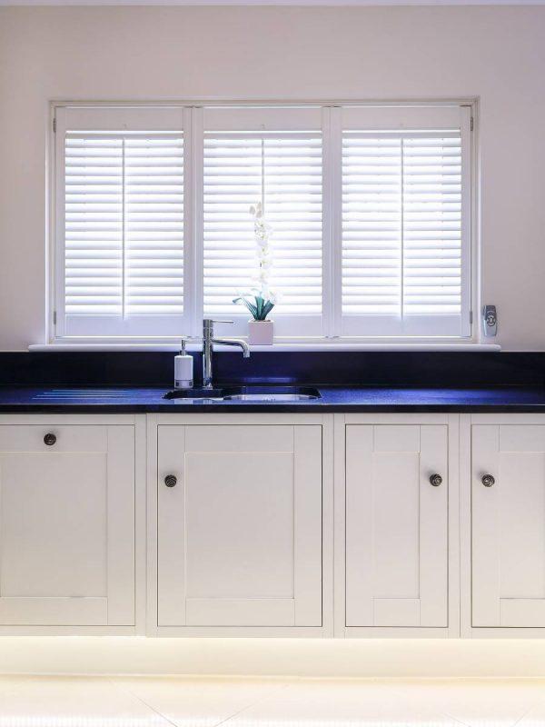 white shutter blinds in white wall kitchen