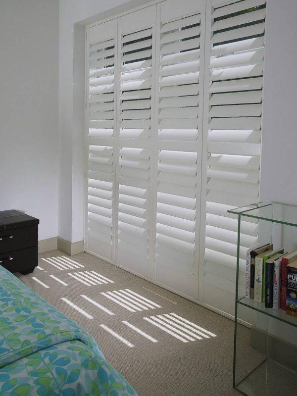 large custom coloured bay windows shutters