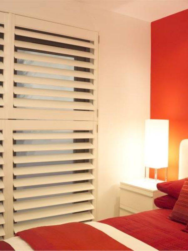 large white shutter blinds bedroom