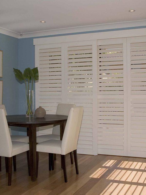 closed inside shutter blinds living room